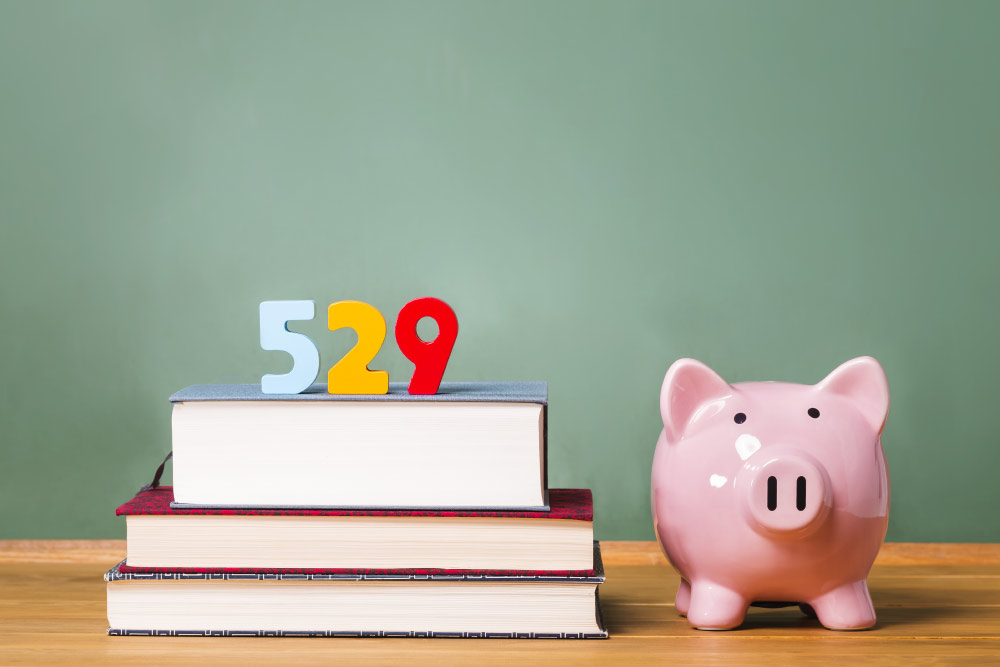 piggy bank with 529 blocks on books